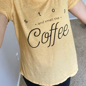 Maurices tee 'stop and smell the coffee'